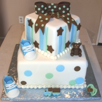 "Baby Shower For A Boy 6"" and 10"" square chocolate cake with lemon cream cheese filling. Everything made from fondant, the shoes, bow, teddy bear,..."