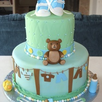 Boy Baby Shower 6 inch white cake with boysenberry IMBC 10 inch chocolate cake with chocolate IMBC. All fondant with fondant clothes line, bear, duck,...