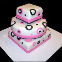 "White 3 Tier With Pink And Black Accents This cake was done for a wedding where they didn't want a ""traditional"" wedding cake. It has 2 black cake boards in between..."