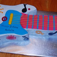 Colorful Guitar This was made for a little girl's birthday. All buttercream and details are MMF
