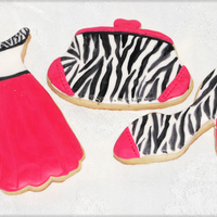 Zebra And Pink Cookies Sugar cookies decorated in fondant and painted with black food coloring with a fine paint brush