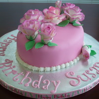 Rose Birthday Cake Strawberry cake with buttercream icing and covered in fondant. Roses are gumpaste.