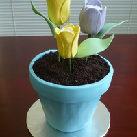 Flower Pot Cake With Tulips Flower pot is pound cake covered with buttercream and fondant. Dirt is crushed Oreos. Flowers are marshmellows covered with buttercream and...