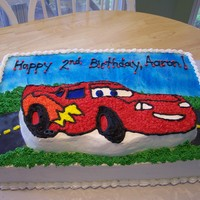 Cars Birthday Cake Cake I made for a 2 year old birthday cake. Cars themed. Marble cake with buttercream icing. Cars cake made with Cars Wilton cake pan. Road...