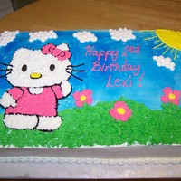 Hello Kitty Birthday Cake Cake I made for my 2 year old niece's birthday - the whole birthday was Hello Kitty themed. I got the idea from other cakes here on CC...