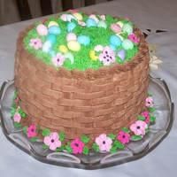 Easter Basket Cake Cake I made for our Easter dinner. Chocolate cake with cookies'n cream filling, iced with chocolate buttercream. Basketweave, piped...