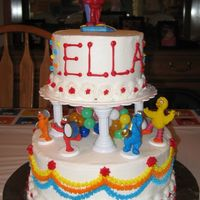 Elmo Birthday Cake   Two-tier buttercream icing cake with Elmo figurines