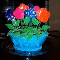 Flower Pot Flowers are cookies and pot is upside down doll pan from Wilton with oreo cookies as the dirt