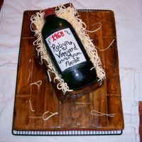 Wine Bottle Cake   Entire cake (bottle and crate) is edible - board is covered in fondant and then painted with food coloring