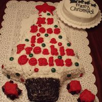 Christmas Tree & Moon This was for an office Christmas Party. I used a Wilton Christmas Tree Pan and piped the buttercream frosting using a star tip. For the...