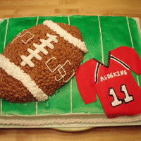 High School Football Cake Football cake for a friend of mines son who plays on his high school football team. I made the jersey to actually look like his jersey.