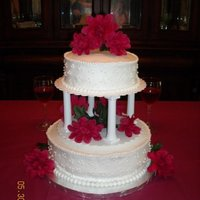 Round Wedding The round tier cake was actually used for a 40th anniversary celebration. The client wanted to use silk flowers to match with other...