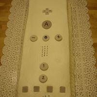 Wii Remote I cute a half sheet in half and stacked, iced with buttercream. Buttons are gumpaste.