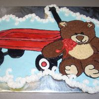 Red Wagon And Teddy Bear This is a cupcake cake made with 50 cuppies. Half are white cake with raspberry cream filling, other half are triple chocolate chunk. All...