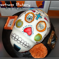 Day Of The Dead Skull Cake I loved making this cake! The cake was covered in fondant and then hand painted. All decor is either, chocolate, RI, or fondant. Thanks for...