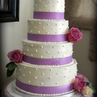 Simple Lavender Wedding Cake 12,10, 8, and 6 inch rounds to make up this massive cake.Travelled over 2 hours with this cake completely set up and was very nervous...