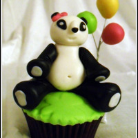 Panda Cuppy This was made for my friend who I call Panda..Made entirely of fondant