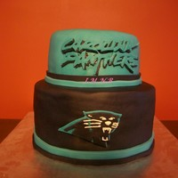 Panthers Cake Triple chocolate cake, with peanut butter filling and MMF. This cake was so yummy... It was made for my son's 12th birthday.