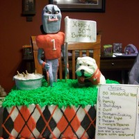 Georgia Bulldog Uga/hairy Dawg/ice Chest This is a vanilla cake with buttercream. UGA and Hairy the Dawg are made out of modeling chocolate. The ice chest, beer bottles,flag, and...