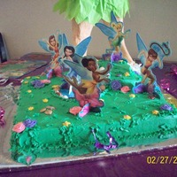 Tinkerbell And Fairies  I purchased this punchout kit from walmart and created the landscape for the fairies. made a pond surrounded by chocolate rocks. kids were...