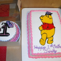 "Winnie The Pooh This was a 1/4 sheet and a 6"" smash cake for a 1st Birthday. I transferred the outline of pooh onto the cake and filled in with star..."