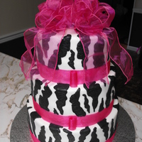 Zebra Birthday 3 tier chocolate on the bottom tier and white cake the other 2 tiers. Freehanded the zebra print kinda had fun with this one. TFL