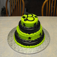 Green And Black With Stars This was a 4 single layer Strawberry and funfetti cake for my daughters 11th Birthday. She wanted the green and black with stars. The B on...