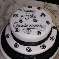 "Black And White Anniversary 8 & 6"" white cake iced with BC, and black ribbon trimming the bottom of each layer.TFL"