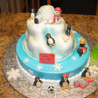 Penguins Birthday Cake My son asked for a penguin cake so here is what I came up with.This was alot of first for me, the penguins , snowman and igloo are gumpaste...