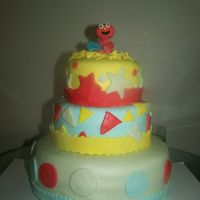 Elmo Cake   Still trying to learn how to make fondant figures..