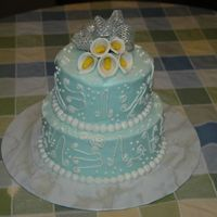First Scroll Work Cake   Tifany blue icing with white BC scroll work...All BC. Gumpaste calla lillies on top with real ribbon bow.
