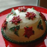 Christmas 2006 Cake, First Try At Poinsettias And Holly Round Chocolate and White Chocolate Mouse Cake with White Chocolate Almond Icing. Poinsettias were made on foil in a shot glass (I don&#039...
