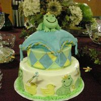 "Froggy Tales  This is a 12""& 8"" round and an 8"" square pillow. BC with fondant accents, and figures. The 3D frog is gumpaste and..."