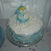 "Snowman Baby Shower Baby shower cake for my grandson due in February. Fondant snowman and snowballs. Fluffy BC icing for ""snow""."