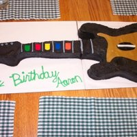 Rockband!  This cake is to a full scale guitar. This was for my brothers 18th birthday. It was a snickerdoodle cake w/cinnamon buttercream. It was...