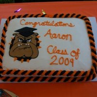 Happy Graduation!!   This a dbl layer marbled 11x13cake. Frosted in buttercream w/a royal transfer.