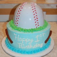 1St Birthday  This is 8inch dbl covered in almond buttercream. The bats are mmf. The baseball is just a plastic hat that I cut the bill off of. It was...