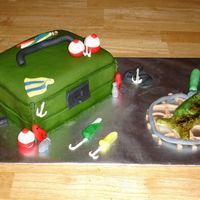 Tackle Box Cake Tackle box covered in fondant with fondant and royal icing decorations. Fish is sculpted in fondant and painted with watered down food...