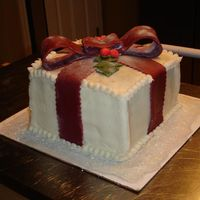 Christmas Cake Christmas Cake with buttercream icing and fondant bow. I used the paint roller method with the crusting buttercream.