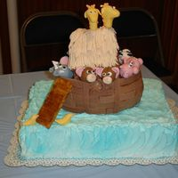 Noahs_Ark_3.jpg Noah's ark cake for baby shower with mmf animals and chocolate mmf ark planks. Buttercream airbrushed water.