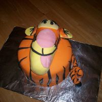 Tigger 3D Tigger cake with fondant. The head is sculpted cake covered in fondant.