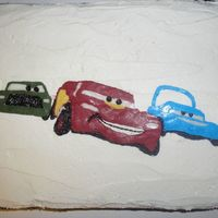 Racing Cars Frozen BC frosting transfer on 2-layer chocolate cake with BC frosting.