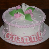 Granny Rose Cake Made for a grandmother on Mother's Day. Fonant leaves and flowers and white chocolate letters.