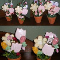 Flower Pot Cookie Bouquets Made for Mother's Day, Sugar cookies with some chocolate roses and lettering and decorated up with plastic flowers