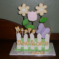 Mother's Flower Garden Mother's Day Cake - The fence, flowers & butterfly are all sugar cookies. The dirt is chocolate graham crackers and the letters...