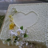White Cake Double Layer Moist Chocolate Cake with buttercream icing and sugar paste flower for wedding.