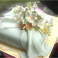 Wedding Gift Cake. Butter cake with white fondant and sugarpaste flowers.