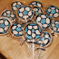 "Blue/black Soccer Ball Cookies   Soccer ball cookies made for my son's soccer team on his 5th birthday. Their team colors in royal icing and ""5""."