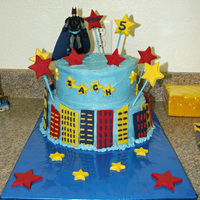 "Batman Birthday Cake Batman themed 5th birthday cake for my son. 10"" and 8"" tiers, all decorations made from chocolate, Batman toy on top. Design idea..."