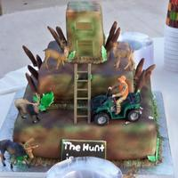 "1St Grooms Cake The sign on the front says ""The Hunt is Over"""